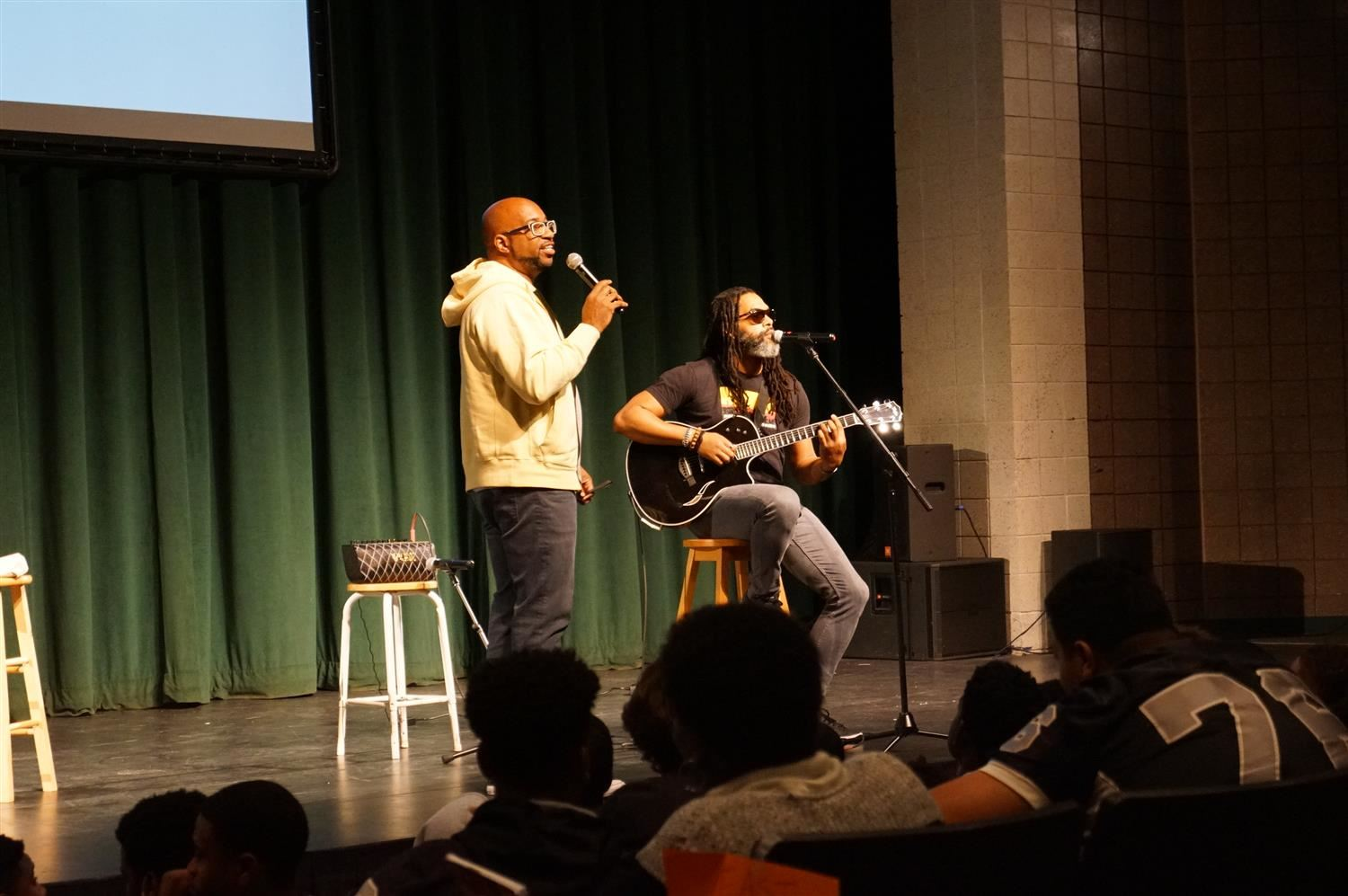 Kwame Alexander and RP on stage at East